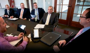 Smart Choice sales executives (opposite side of table from right to left) Paul Taylor, Executive Vice President; Oliver Travieso, Vice President, Sales & Distribution; Ashley Wingate, Vice President Sales, East Coast; and Steve Ford, Vice President, Commercial Lines meet with Andrew Caldwell, President (right) and carrier partner representatives.