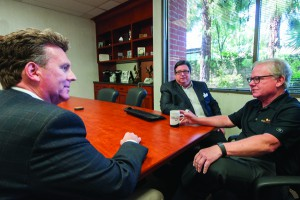 Wayne Dennen (left), who heads up the agency's financial services department, and Jerry meet with client Bill Ross, co-owner of Bar Bakers, LLC, one of the largest private contract-manufacturing operations in the nation producing nutritional cookies, wafers and bars.