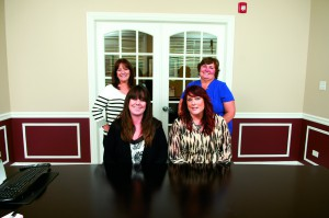 The Personal Lines Team. Sitting from left: Rochelle Krouse, Personal Lines Specialist, and Charity Weber, Personal Lines Specialist. Standing from left: Jeanne Dominy, Personal Lines Specialist, and Christine J. Broholm, Personal Lines Manager.