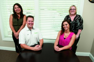 The Commercial Lines Team. Sitting from left: Scott M. Elmlund, and Nicole Clemans, Insurance Consultant. Standing from left: Niki Block, Account Manager, and Jeannine Blase, Account Manager.