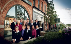 The Whims Insurance Agency, Inc. commercial lines team includes: (seated left to right) Gladys B. Lazzara; Susan Bakke; Connie Klix Mercer; Tricia Judge Fricke; Heidi Schluessler; (standing left to right) Eric Putman; Elizabeth Hurst; Andrew Muma; Amanda Galat; Tom Klix; John Tocco; and Lars Nordberg.